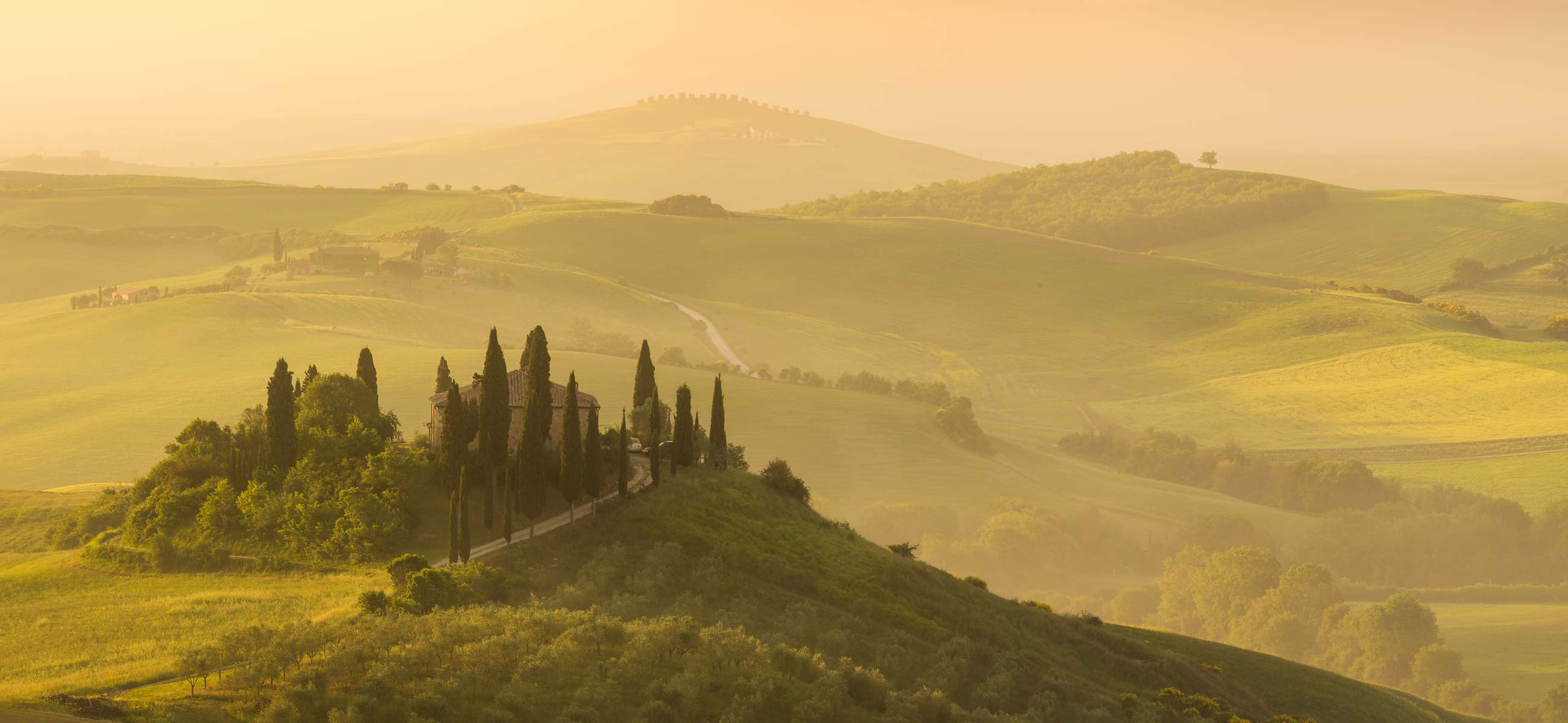 Podere Belvedere in Val d'Orcia, Tuscany on a hazy morning with side light during sunrise