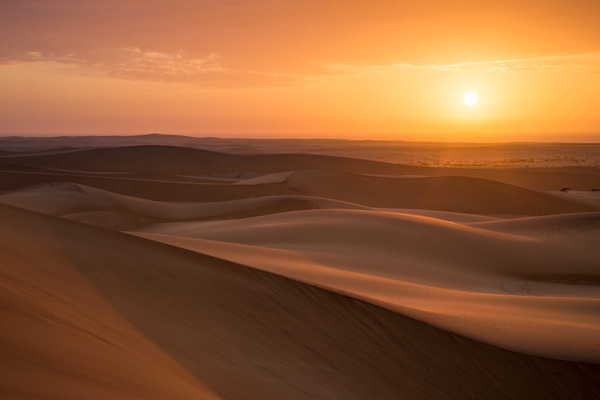 Waves of sand in the dunes near Swakopmund at sunset