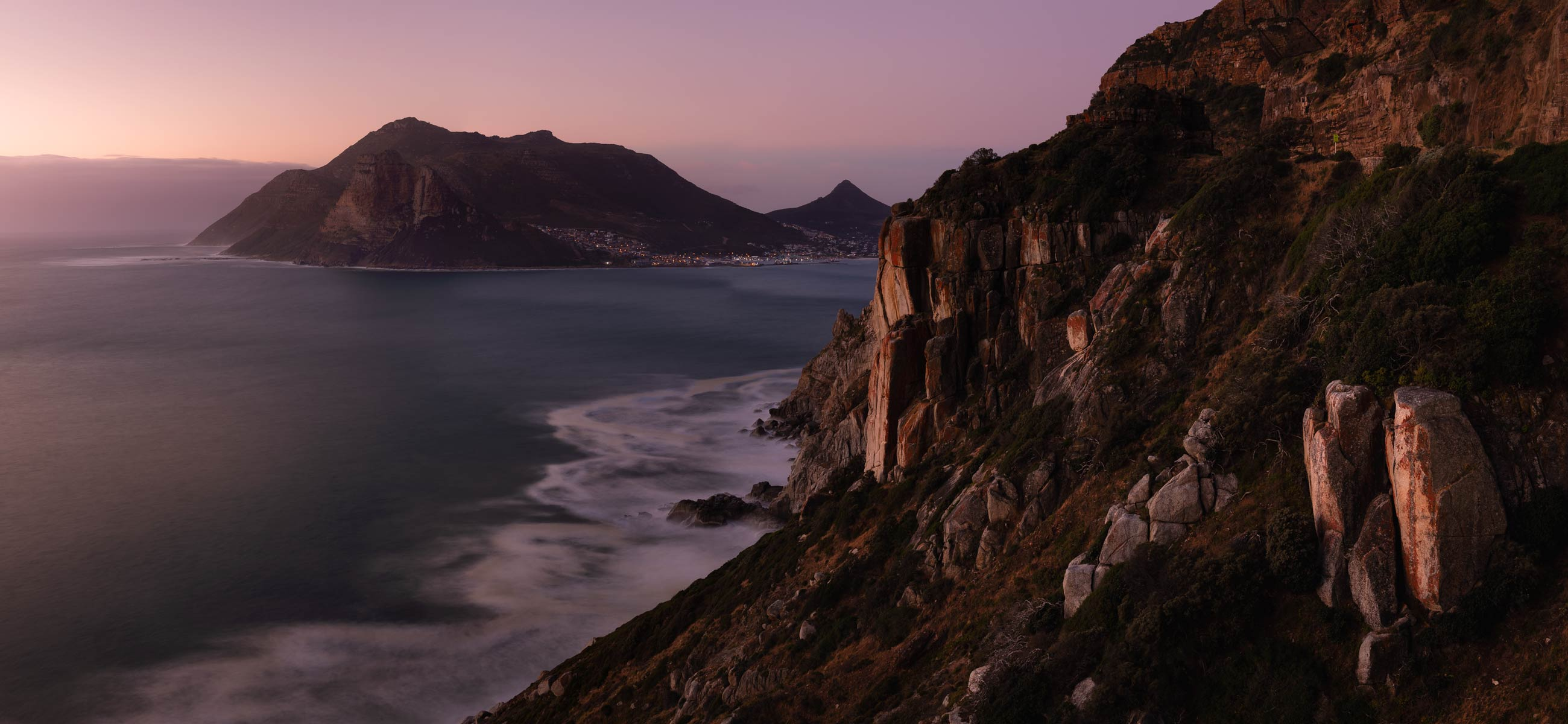 Chapman's Peak watching the Sentinel near Houtbay with a pink sky